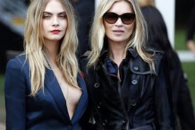 Model Cara Delevingne (L) and Kate Moss.