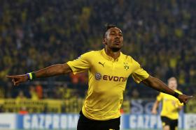 Borussia Dortmund's Pierre-Emerick Aubameyang celebrates after scoring a goal against Arsenal during their Champions League group D soccer match.