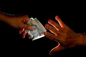 File photo of a bribery attempt. A man, who had been arrested, offered a police office a whooping $2 million to release him. The officer rejected the bribe.