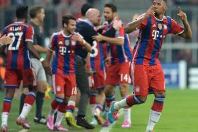 Bayern Munich's defender Jerome Boateng celebrates after scoring the only goal in the first leg UEFA Champions League Group E football match against Manchester City in Munich.