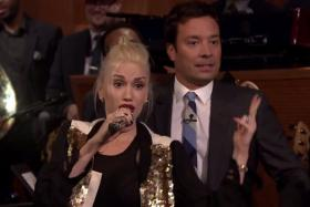 Gwen Stefani (left) and Jimmy Fallon during a lip sync battle on The Tonight Show Starring Jimmy Fallon.