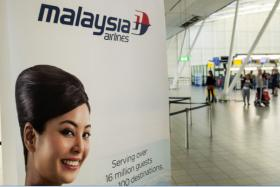 This picture taken on September 9, 2014 shows an advertising banner for Malaysia Airlines at Schiphol Airport, near Amsterdam.