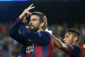Barcelona's Gerard Pique (L) celebrates a goal next to Neymar against Apoel Nicosia during their Champions League soccer match at Camp Nou stadium in Barcelona September 17, 2014.