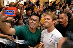 MR POPULAR: The crowd at The Paragon can't get enough of Nico Rosberg (right), who is top of the drivers' standings.