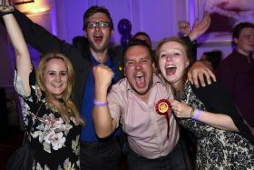 """Supporters from the """"No"""" Campaign celebrate at the Better Together Campaign headquarters in Glasgow, Scotland Sept 19, 2014."""