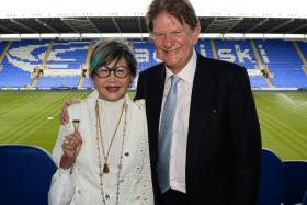 Sir John Madejski (right) will remain as co-chairman of Reading FC, with Khunying Sasima Srivikorn (left) as co-chairwoman.