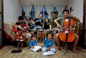 PURSUING PASSIONS: (From left, back row): Isaiah, Isaac, Mrs Ong Suwei, Abigail, Mr Dan Ong, Asher, (front row) Michaela and Magdalena, in their five-room flat at Yishun.