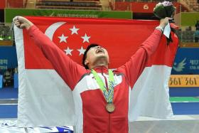 """""""I am exhausted, but I am happy to win Singapore's first medal at this Games and my sport's first-ever Asian Games medal."""" - Fencer Lim Wei Wen (above)"""
