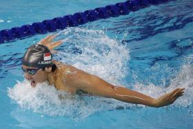 SPLASH AND DASH: Joseph Schooling fighting his way to a 200m butterfly bronze yesterday after falling behind.