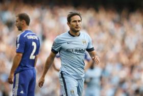 Chelsea players Gary Cahill and Andre Schurrle have admitted that seeing Blues legend Frank Lampard in a lighter shade of blue gave them a strange feeling.