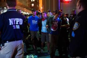 Police officers arrest demonstrators on Broadway following the Flood Wall Street protest after asking them to disperse on September 22, 2014 in New York City.