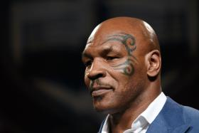 Mike Tyson helped a motorcyclist keep calm after his accident.