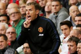 Phil Neville believes Manchester United will have to spend even more money on their squad in order to challenge for the EPL title.
