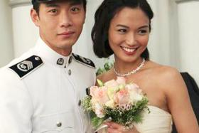 A still from the local TV series C.L.I.F. 2 starring the married couple, Qi Yuwu (left) and Joanne Peh.