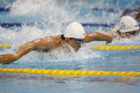 Joseph Schooling competing in the Asian Games 100m butterfly heats.