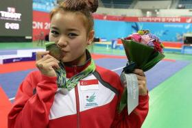 """""""I was particularly pleased with my jump because I had to land on my toes. I hurt my toe again when I practised my moves about an hour before the competition and couldn't move at all for five minutes."""" — Singapore's bronze-medallist Tan Yan Ni (above), who scored 9.63, just 0.01 point ahead the fourth-placed Vietnamese Hoang Thi Phuong Giang"""