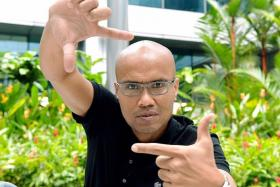 HAPPY TO FLY FLAG: Film-maker Sanif Olek is proud to represent Singapore with his debut movie Sayang Disayang.