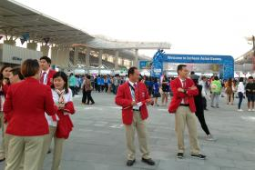 Poh Lip Meng (L) and Lim Swee Hon (R) are part of the shooting team that won a bronze medal for Singapore.