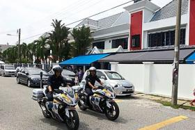 Police officers patrolling the area where a housewife was robbed on Monday.