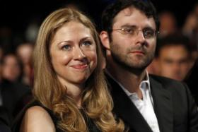 Chelsea Clinton, daughter of former US President Bill Clinton, sits with her husband Marc Mezvinsky as U.S. President Barack Obama speaks at the Clinton Global Initiative in New York, in this file picture taken September 21, 2011.
