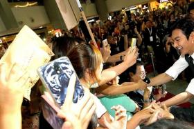 CHARMED: (Above) Lee Min Ho shaking hands with fans at Causeway Point.