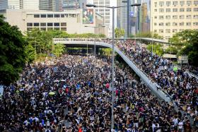 Pro-democracy protesters gathering along roads near the government headquarters in Hong Kong on Sept 29.