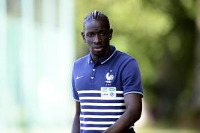 Liverpool defender Mamadou Sakho has apologised to supporters for leaving Anfield before the Merseyside derby against Everton on Saturday.