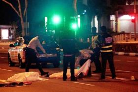 DEAD: Mr Zainudin Muhammad was seen arguing with an unknown woman before lying in the middle of the road.