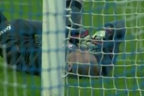 Joao Carlos is flattened after scoring an incredible own goal with his face.