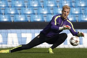 Joe Hart insists that he is enjoying the challenge of competing against Willy Caballero at Manchester City.
