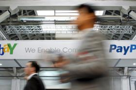 US online auction giant eBay on Tuesday agreed to shareholders' requests for a split, making its highly profitable PayPal brand into an independent company starting next year.