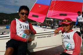 Raynn Kwok (left) with fellow national Optimist sailor Jodie Lai.