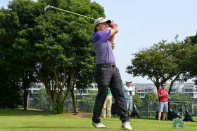 HOT SHOTS: Jeffrey Wong (above) posted the joint-best gross score of 77 at the SPH-WGC yesterday while Pauline Quah bagged a hole-in-one.