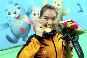 Asian Games organisers on Tuesday expelled Malaysia's wushu gold medal-winner Tai Cheau Xuen after she failed a drug test, becoming the tournament's third doping case.