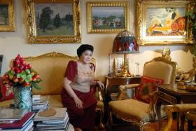 This file photo taken on June 7, 2007 shows former first lady Imelda Marcos is seen in her apartment in Manila with a gallery of paintings including a Picasso, seen at upper right.