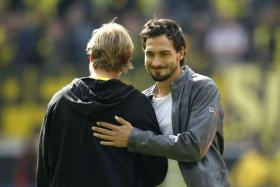 Mats Hummels might be flattered by interest from Europe's top clubs, but insists he is happy with his pay cheque at Borussia Dortmund.