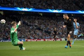 Francesco Totti chips the ball over Manchester City goalkeeper Joe Hart to score Roma's equaliser.