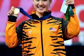 Malaysia's gold medalist Tai Cheau Xuen celebrating during the medal ceremony of the women's wushu nanquan final at the 2014 Asian Games in Incheon on Sept 20.