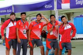 (From left) National sailors Christopher Lim, Russell Kan, Maximilian Soh, Justin Wong and Andrew Paul Chan clinched an Asian Games gold medal for the J80 match racing event.