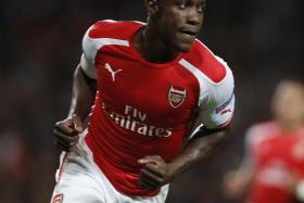 Gary Neville hopes that Arsenal manager Arsene Wenger can turn Welbeck into a world class striker, like the way he did with Henry.
