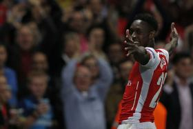 Arsenal's English striker Danny Welbeck celebrates scoring his third goal, Arsenal's fourth during the UEFA Champions League match  against Galatasaray.