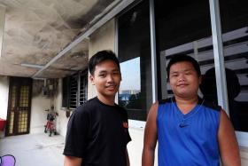 HEROES: David Laxamana (left) and Marcus Tan (right) were playing basketball when they noticed thick smoke billowing from the third storey of a nearby HDB block.