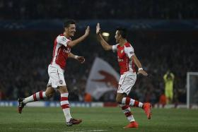 FIREPOWER: Arsenal have quality in their ranks with the likes of Mesut Oezil (left) and Alexis Sanchez (right).