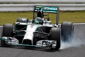 Mercedes driver Nico Rosberg of Germany speeds during the third practice session at the Formula One Japanese Grand Prix in Suzuka on Oct 4.