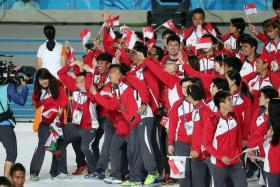 GOOD JOB:Chef de mission Jessie Phua is delighted with Singapore's (above) medal haul at the Asiad.
