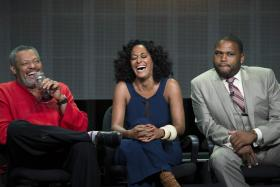 """Cast member and executive producer Anthony Anderson (R) and co-stars Laurence Fishburne (L) and Tracee Ellis Ross attend a panel for the ABC television series """"Black-ish"""" during the Television Critics Association Cable Summer Press Tour in Beverly Hills, California on July 15."""