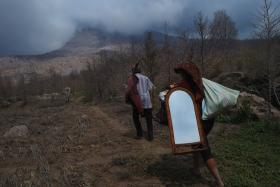 This file picture taken in Sukameriah village on Sept 13, 2014 shows villagers salvaging their stuff. The village sits within a 3km radius of the Mount Sinabung.