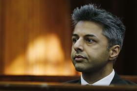 Shrien Dewani sits in the Cape Town High Court on Monday waiting for his trial to start.