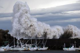 High waves batter a breakwater at a port at Kihou town in Mie prefecture, central Japan, on Monday.