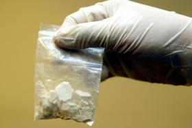 File photo of drugs. A four-year-old girl handed out packets of heroin to friends at daycare in Delaware, thinking they were candy.
